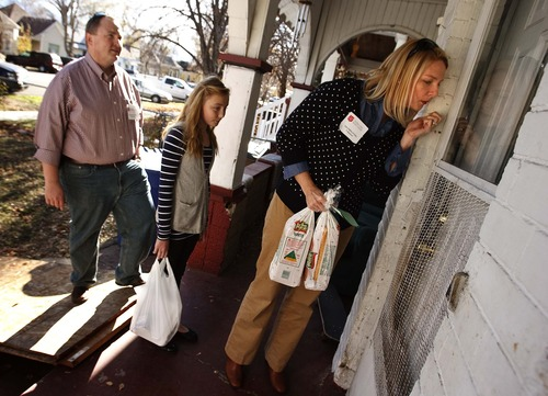 Leah Hogsten  |  The Salt Lake Tribune Salvation Army volunteer Rebecca Bateman, of Fruit Heights, knocks gently at the home of a woman who is homebound in Salt Lake City. Bateman, her daughter Bess, 10, husband David and son Alex, 13 (unseen) deliver food to the needy for the second year with a dozen other family members. On Thursday November 22, 2012 in Salt Lake City the Salvation Army prepared and delivered some 450 Thanksgiving dinners to people who are basically shut in and can't be with friends or family on the holiday.