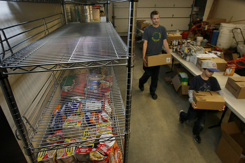 Scott Sommerdorf  |  The Salt Lake Tribune               The mostly empty shelves at the Taylorsville Food Pantry earlier this month.