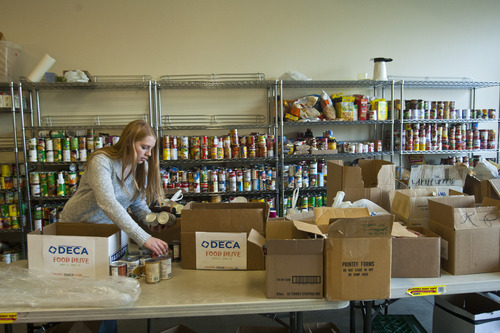 Chris Detrick  |  The Salt Lake Tribune Melody Barlow, 15, helps to organize donated food at the Taylorsville Food Pantry Tuesday November 20, 2012. The last two months of the year are essential for organizations that provide services to Utah's neediest citizens. The Utah Food Bank, for example, collects about 2.5 million pounds of food in drives held from Oct.15 to Jan.15.
