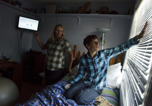 Leah Hogsten  |  The Salt Lake Tribune David Harms, 15, who has autism and suffers from the effects of fetal alcohol syndrome, looks at the blinds in his room as his mother, Susan, tries to focus his attention on his computer-based schoolwork. After frustrating experiences with brick-and-mortar schools, he is attending Utah Virtual Academy.