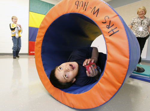 Al Hartmann  |  The Salt Lake Tribune A student rocks inside a padded barrel in the physical therapy room at Whittier Elementary School. The school has a unique special needs wrap-around service hub that features a sensory room and a physical therapy room to accomodate the needs of Whittier's disabled students.