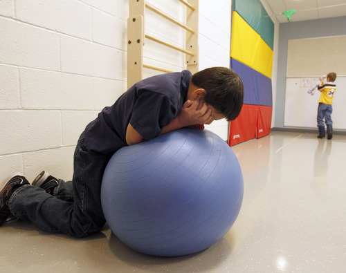 Al Hartmann  |  The Salt Lake Tribune A student rocks on a rubber ball in the physical therapy room at Whittier Elentary School. The school has a unique special needs wrap-around service hub that features a sensory room and a physical therapy room to accomodate the needs of Whittier's disabled students.