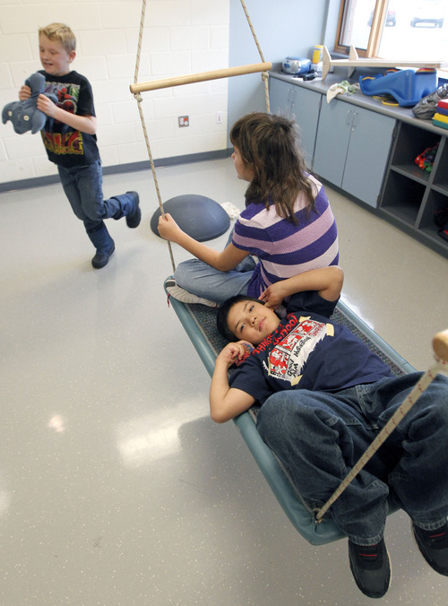 Al Hartmann  |  The Salt Lake Tribune Students swing in the physical therapy room at Whittier Elementary School. The school has a unique special needs wrap-around service hub that features a sensory room and a physical therapy room to accomodate the needs of Whittier's disabled students.