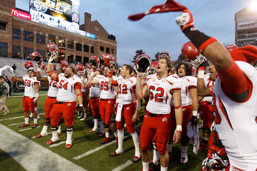 "Trent Nelson  |  The Salt Lake Tribune The Utah team sings ""Utah Man"" following the win as the Colorado Buffaloes host the University of Utah Utes, college football Friday November 23, 2012 in Boulder."
