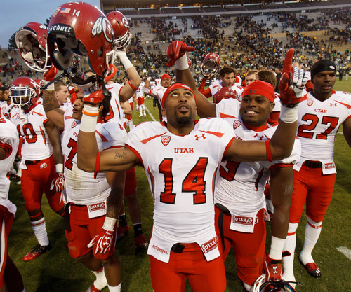 "Trent Nelson  |  The Salt Lake Tribune Utah Utes wide receiver Reggie Dunn (14) and the Utah team sings ""Utah Man"" following the win as the Colorado Buffaloes host the University of Utah Utes, college football Friday November 23, 2012 in Boulder."