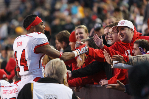 Trent Nelson  |  The Salt Lake Tribune Utah Utes wide receiver Reggie Dunn (14) celebrates with fans after the win as the Colorado Buffaloes host the University of Utah Utes, college football Friday November 23, 2012 in Boulder.
