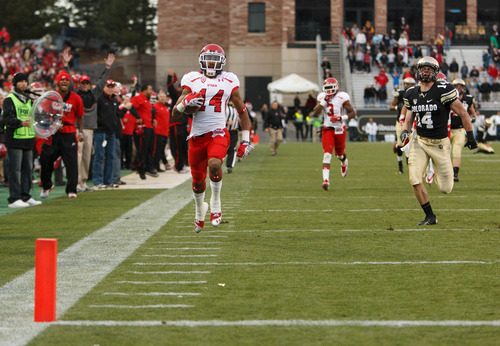 Trent Nelson  |  The Salt Lake Tribune Utah Utes wide receiver Reggie Dunn (14) returns a kick for a touchdown in the fourth quarter as the Colorado Buffaloes host the University of Utah Utes, college football Friday November 23, 2012 in Boulder.