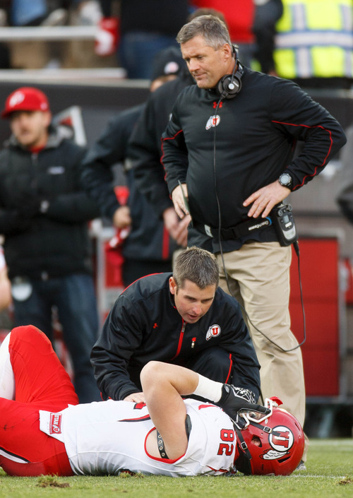 Trent Nelson  |  The Salt Lake Tribune Utah Utes head coach Kyle Whittingham stands over an injured Utah Utes tight end Jake Murphy (82) after Murphy put a hard block on a Colorado player that led to a Travis Wilson (7) touchdown as the Colorado Buffaloes host the University of Utah Utes, college football Friday November 23, 2012 in Boulder.