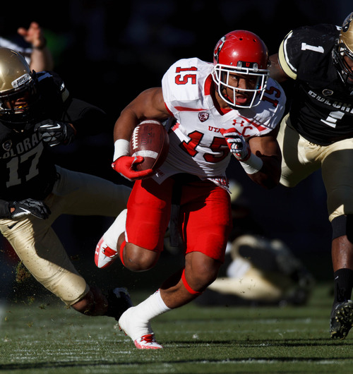 Trent Nelson  |  The Salt Lake Tribune Utah running back John White runs the ball in the second quarter as the Colorado Buffaloes host the University of Utah Utes, college football Friday November 23, 2012 in Boulder.