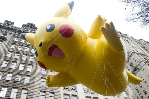 FILE - This Nov. 26, 2009 file photo shows the Pikachu Pokemon balloon floating down Central Park West during the Macy's Thanksgiving Day Parade in New York. The parade has to be a crowd-pleaser for a multigenerational crowd. More than 3 million people typically attend the event that also unfolds in front of a TV audience of 50 million. This year's parade will feature balloons include Papa Smurf and the Elf on a Shelf, while Buzz Lightyear, Sailor Mickey Mouse and the Pillsbury Doughboy keep their place in the lineup. A new version of Hello Kitty is also to be included. (AP Photo/Charles Sykes, file)