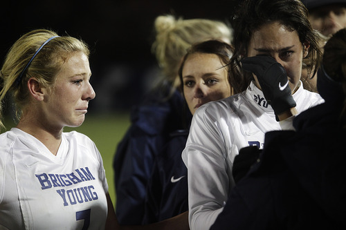 Brigham Young's Carlee Payne Holmoe and Lindsi Lisonbee Cutshall react after losing to North Carolina during an NCAA college Elite Eight soccer tournament game in Provo, Utah on Friday, Nov. 23, 2012. (AP Photo/The Daily Herald, Jim McAuley)
