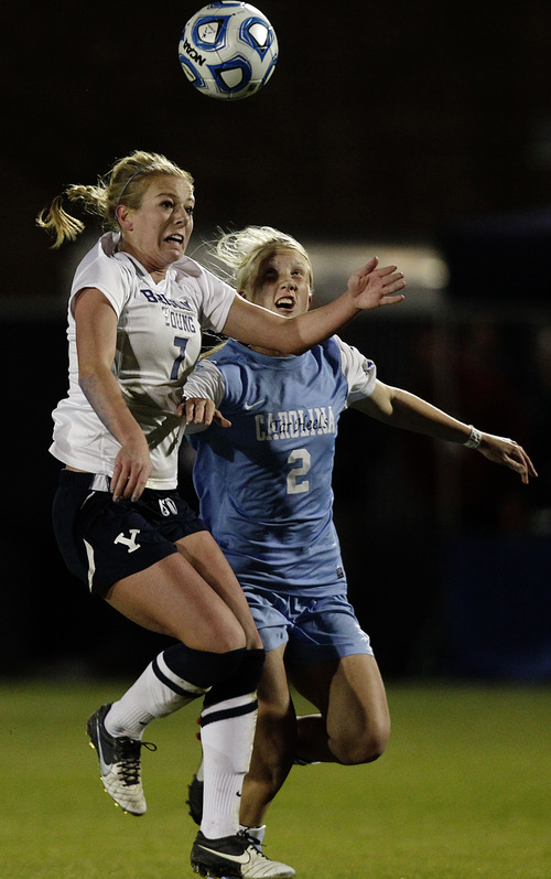 Bringham Young's Carlee Payne Holmoe,  left, goes for a header against North Carolina's Caitlin Ball, right, during the NCAA college soccer Elite Eight tournament game at BYU in Provo, Utah, Friday, Nov. 23, 2012. (AP Photo/Daily Herald, Jim McAuley)