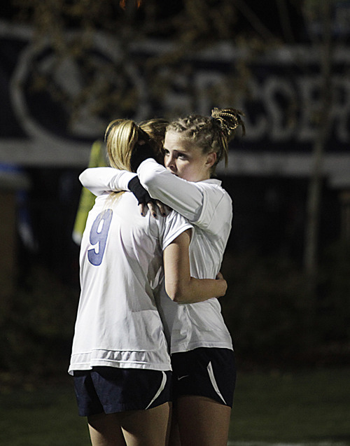 Bringham Young's Jaiden Thornock consoles teammate Paige Hunt losing to North Carolina in the NCAA college soccer Elite Eight tournament game at BYU in Provo, Utah, Friday, Nov. 23, 2012. (AP Photo/Daily Herald, Jim McAuley)