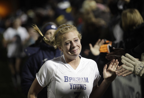 Brigham Young's Carlee Payne Holmoe runs the stands for one last time after BYU lost to North Carolina during an NCAA women's Division I soccer tournament quarterfinal, Friday, Nov. 23, 2012, in Provo, Utah. (AP Photo/Daily Herald, Jim McAuley)