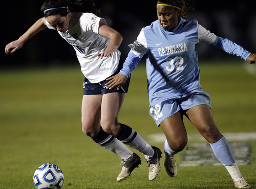 Bringham Young's Michele Murphy, left, battles for the ball with North Carolina's Meg Morris during an NCAA college soccer Elite Eight tournament game at BYU in Provo, Utah, Friday, Nov. 23, 2012. (AP Photo/Daily Herald, Jim McAuley)