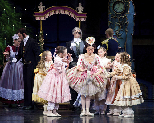 """Children gather around the life-size doll during Ballet West's production of The Nutcracker. Photo credit: Artists of Ballet West in Willam Christensen's """"The Nutcracker."""" Photo by Luke Isley."""