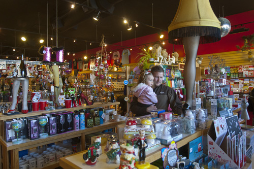 "Chris Detrick     The Salt Lake Tribune Brandon Christensen, of Layton, and his daughter, Macie, 2, shop at Cahoots in Salt Lake City on ""Small Business Saturday."""