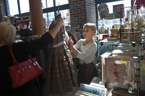 "Chris Detrick  |  The Salt Lake Tribune Taylor Reardon, 10, and her mom, Kristi, of Sandy, shop at The Children's Hour in Salt Lake City on ""Small Business Saturday."""