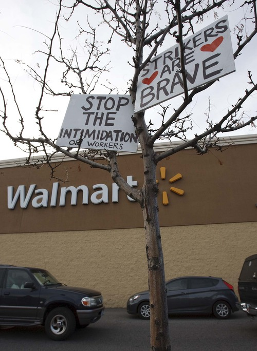 Leah Hogsten  |  The Salt Lake Tribune As countless cars enter and exit the store on Black Friday, friends and family of Walmart employees protested working conditions during a Walmart Workers Walkout Solidarity Rally on Black Friday at the Walmart located at 300 West and 1300 South, Salt Lake City Friday November 23, 2012 in Salt Lake City.