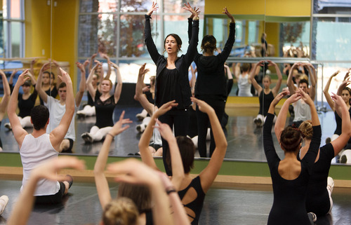 Trent Nelson  |  The Salt Lake Tribune Students stretch with instructor Staci DeVoogt in a ballet class at the Pioneer High School for the Performing Arts Tuesday November 13, 2012 in American Fork.