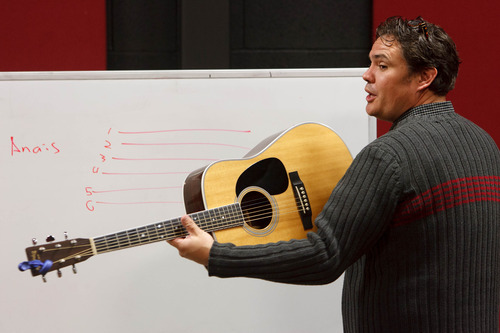 Trent Nelson  |  The Salt Lake Tribune Sam Payne teaches an Intro to Guitar class at the Pioneer High School for the Performing Arts Tuesday November 13, 2012 in American Fork.