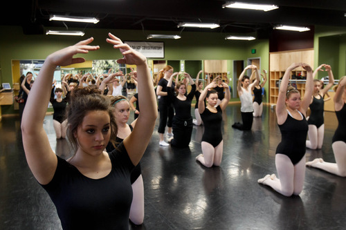 Trent Nelson  |  The Salt Lake Tribune Students stretch in a ballet class at the Pioneer High School for the Performing Arts Tuesday November 13, 2012 in American Fork.