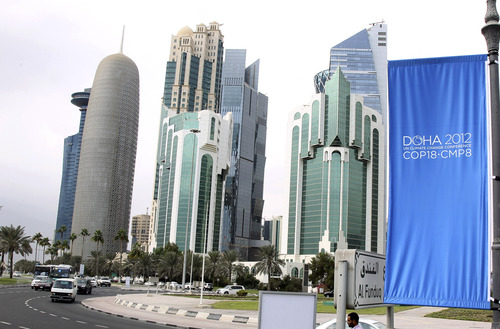 In this Wednesday, Nov. 20, 2012 photo, conference flags are displayed ahead of the Doha Climate Change Conference, in Doha, Qatar, Wednesday, Nov. 20, 2012. The eighteenth session of the Conference of the Parties (COP 18) will take place from Monday, Nov. 26 to Friday, Dec. 6, 2012.(AP Photo/Osama Faisal)