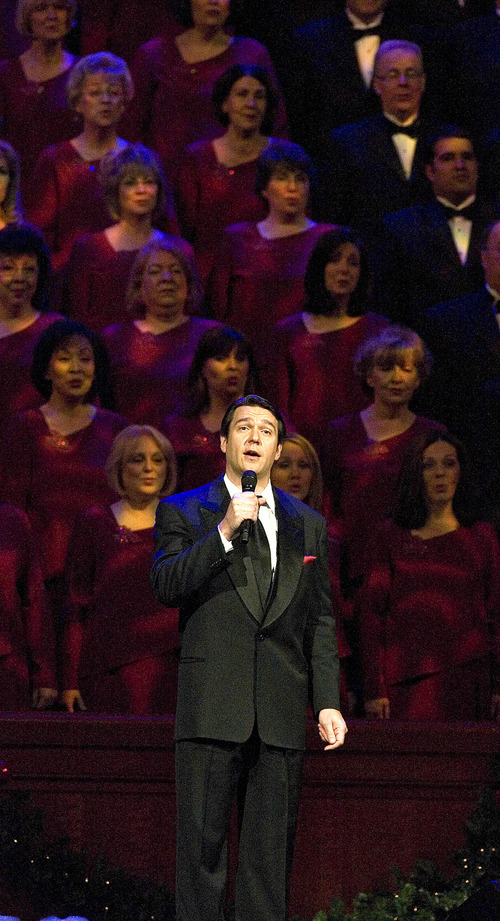 Paul Fraughton | The Salt Lake Tribune With the choir singing backup, guest star Nathan Gunn sings at The Mormon Tabernacle Choir's 2011 Christmas extravaganza at the LDS Conference Center.