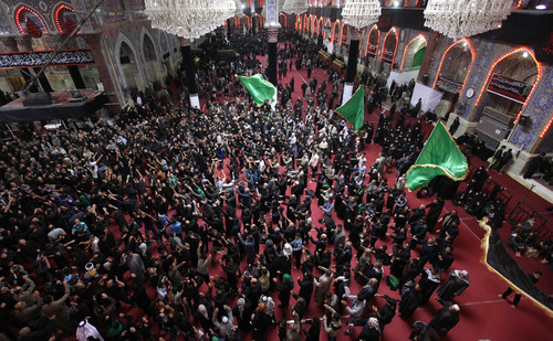 Shiite Muslim worshippers gather inside the holy shrine of Imam Hussein to mark the Muslim festival of Ashoura, an important period of mourning for Shiites in Karbala, 50 miles (80 kilometers) south of Baghdad, Iraq, Saturday Nov. 24, 2012. The festival of Ashoura commemorates the martyrdom of Imam Hussein, the grandson of Prophet Muhammad at the Battle of Karbala, Iraq, in the year A.D. 680. (AP Photo / Khalid Mohammed)