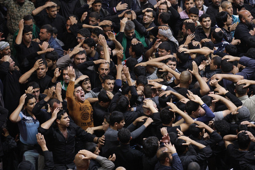 Shiite Muslim worshippers beat themselves inside the holy shrine of Imam Hussein to mark the Muslim festival of Ashoura, an important period of mourning for Shiites in Karbala, 50 miles (80 kilometers) south of Baghdad, Iraq, Saturday Nov. 24, 2012. The festival of Ashoura commemorates the martyrdom of Imam Hussein, the grandson of Prophet Muhammad at the Battle of Karbala, Iraq, in the year A.D. 680. (AP Photo / Khalid Mohammed)