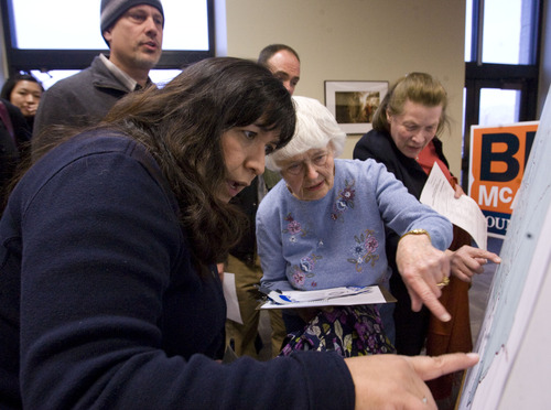 Leah Hogsten  |  Tribune file photo State Rep. Rebecca Chavez-Houck (left) helps Sue Marquardt find her way to the right precinct group. Chavez-Houck, a Democrat from Salt Lake City, isn't surprised at Utah's low voter turnout. She's been pushing for years to try and boost participation.