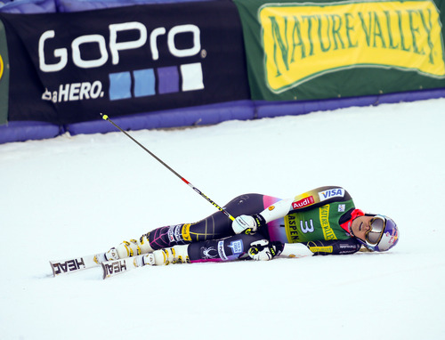 Nathan Bilow | The Associated Press Lindsey Vonn of the United States, collapses in the finish arena after her second run in the women's World Cup giant slalom ski race in Aspen, Colo., on Saturday, Nov. 24, 2012. . (AP Photo/ Nathan Bilow)