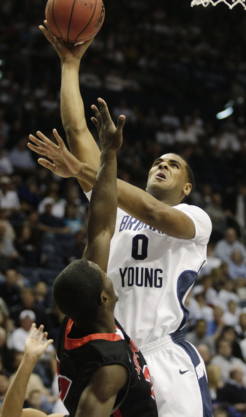Brigham Young's Brandon Davies drives to the basket against Cal State Northridge during the first half of an NCAA college basketball game Saturday, Nov. 24, 2012, in Provo, Utah. (AP Photo/Provo Daily Herald, Jim McAuley)