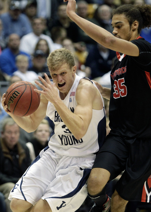 Brigham Young's Tyler Haws (3) drives to the basket against Cal State Northridge's Tre Hale-Edmerson (35) during an NCAA college basketball game in Provo, Utah, on Saturday, Nov. 24, 2012. (AP Photo/The Daily Herald, Jim McAuley)