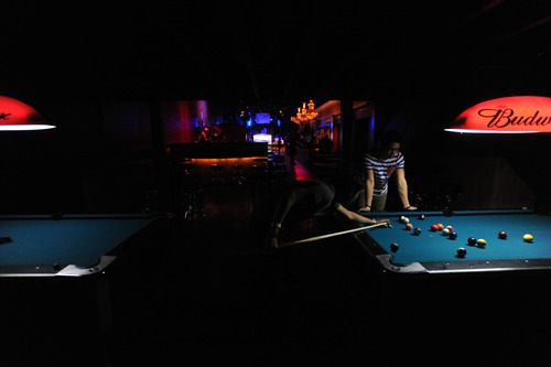 Stephen Speckman  |  Special to the Tribune Halloween revelers enjoy a game of pool before a concert featuring DJ StoneBridge and vocalist Krista Richards at Mixx, 615 W. 100 South, Salt Lake City.