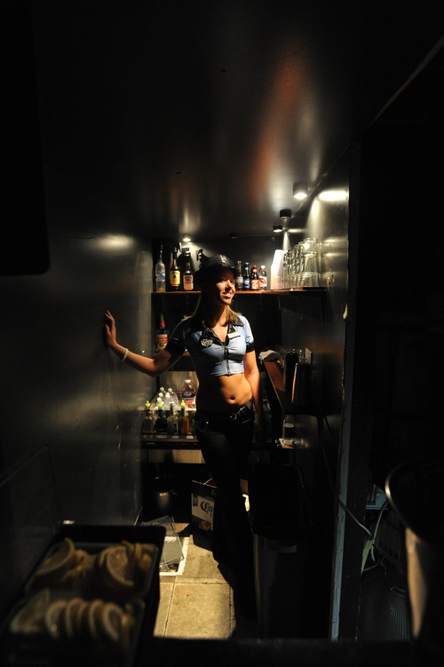 Stephen Speckman  |  Special to the Tribune Bartender Danielle Donaldson waits on customers in a small, narrow bar just off of an upstairs VIP room at Mixx, 615 W. 100 South, Salt Lake City.