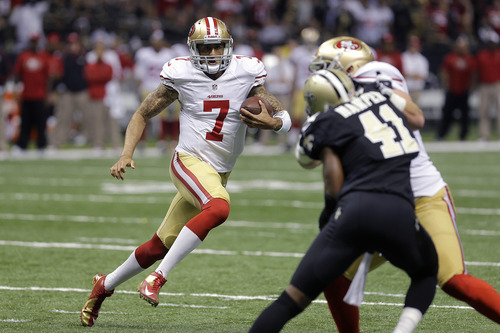 San Francisco 49ers quarterback Colin Kaepernick (7) scrambles for a touchdown in the first half of an NFL football game against the New Orleans Saints at the Louisiana Superdome in New Orleans, Sunday, Nov. 25, 2012. (AP Photo/Bill Haber)
