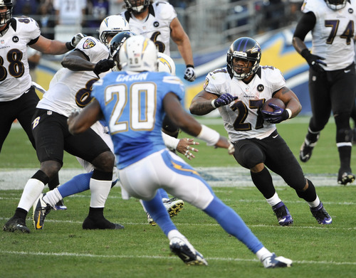 Baltimore Ravens running back Ray Rice sets up their game tying field goal with a 30-yard run against the San Diego Chargers during the second half of an NFL football game Sunday, Nov. 25, 2012, in San Diego. (AP Photo/Denis Poroy)