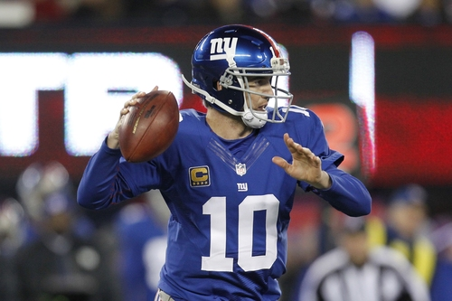 New York Giants quarterback Eli Manning (10) throws a pass during the first half of an NFL football game against the Green Bay Packers Sunday, Nov. 25, 2012 in East Rutherford, N.J. (AP Photo/Julio Cortez)