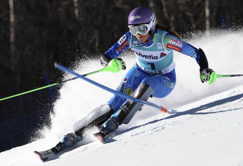 Slovenia's Tina Maze speeds down the course during the women's World Cup slalom ski race in Aspen, Colo., Sunday, Nov. 25, 2012. (AP Photo/Alessandro Trovati)