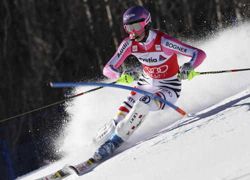 Germany's Maria Hoefl-Riesch speeds down the course during the women's World Cup slalom ski race in Aspen, Colo., on Sunday, Nov. 25, 2012.  (AP Photo/Alessandro Trovati)