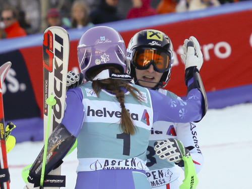 Austria's Kathrin Zettel, right, receives a hug form Tina Maze, of Slovenia, in the finish arena after winning the women's World Cup slalom ski race in Aspen, Colo., on Sunday, Nov. 25, 2012. (AP Photo/Nathan Bilow)