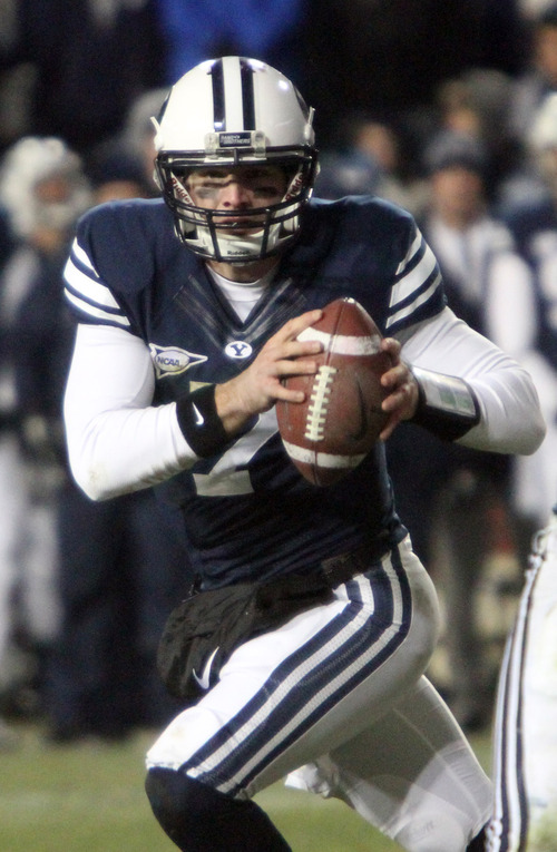 Rick Egan  | The Salt Lake Tribune   Brigham Young Cougars quarterback James Lark (7) scrambles with the ball,  in football action, BYU vs. Idaho Vandals, at Lavell Edwards Stadium, Saturday, November 10, 2012