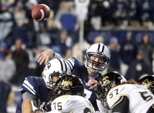 Rick Egan  | The Salt Lake Tribune   Brigham Young Cougars quarterback James Lark (7) thows a touchdown pass to Brigham Young Cougars wide receiver Cody Raymond (31) in football action, BYU vs. Idaho Vandals, at Lavell Edwards Stadium, Saturday, November 10, 2012