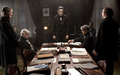 "This undated publicity photo released by DreamWorks and Twentieth Century Fox shows, Daniel Day-Lewis, center rear, as Abraham Lincoln, in a scene from the film, ""Lincoln."" David Strathairn, center right, plays Lincoln's Secretary of State, William Seward. (AP Photo/DreamWorks and Twentieth Century Fox, David James)"