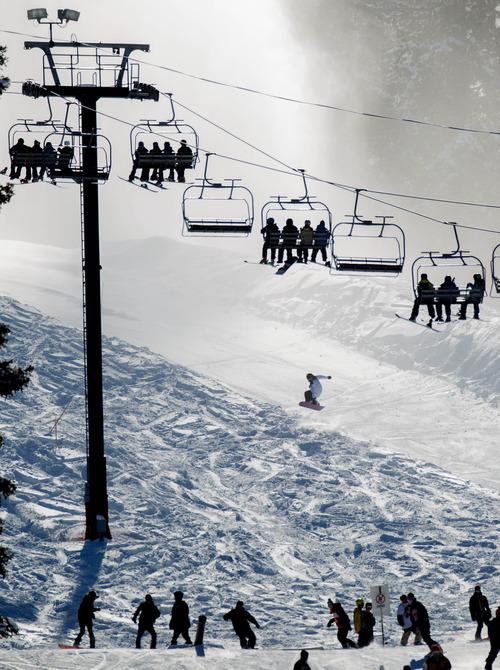 Trent Nelson     The Salt Lake Tribune Ski lifts were full on opening day at Brighton Ski Resort, Tuesday, Nov. 13, 2012.