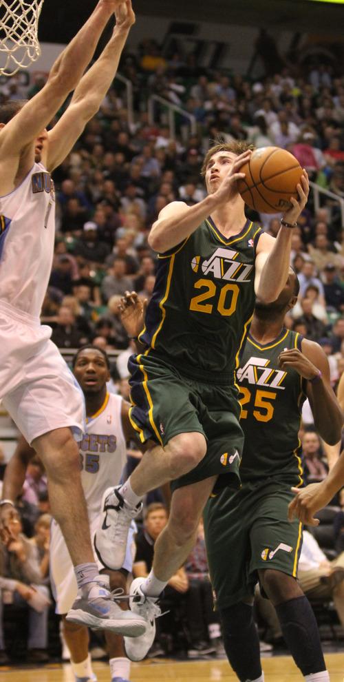 Rick Egan  | The Salt Lake Tribune   Utah Jazz shooting guard Gordon Hayward (20) goes up for a shot as Jordan Hamilton (1) defends, in NBA action, Utah vs. the Denver Nuggets, in Salt Lake City, Monday, November 26, 2012.