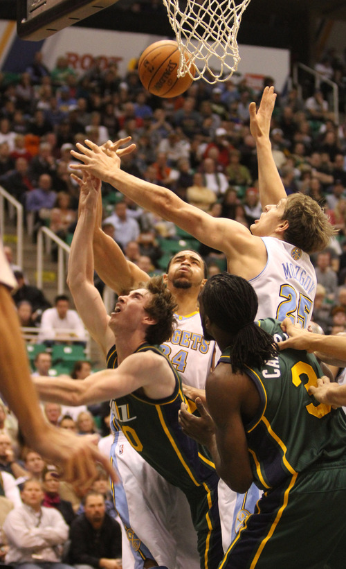 Rick Egan  | The Salt Lake Tribune   Utah Jazz shooting guard Gordon Hayward (20)is double teamed by Denver Nuggets point guard Andre Miller, and  Timofey Mozgov (25)as he goes up for a shot,  in NBA action, Utah vs. the Denver Nuggets, in Salt Lake City, Monday, November 26, 2012.