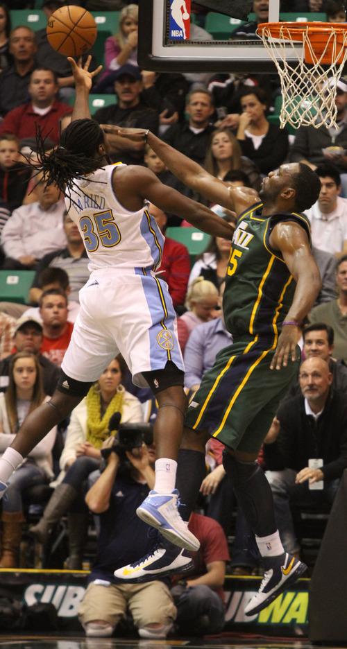 Rick Egan  | The Salt Lake Tribune   Utah Jazz center Al Jefferson (25) defends as Kenneth Fairied (35), shoots for Denverin NBA action, Utah vs. the Denver Nuggets, in Salt Lake City, Monday, November 26, 2012.