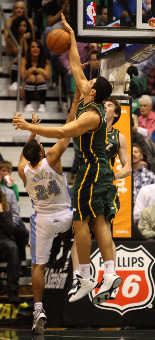 Rick Egan  | The Salt Lake Tribune   Utah Jazz center Enes Kanter (0) blocks a shot by Denver Nuggets point guard Andre Miller (24). Utah defeated Denver 105-103 in NBA action, in Salt Lake City, Monday, November 26, 2012.